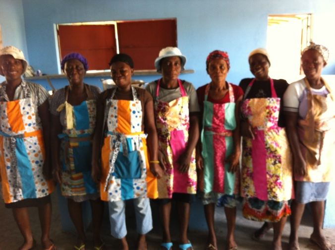 our beautiful cooks! (wearing aprons made by the Denim Project: a sewing project employing other local women in the community)