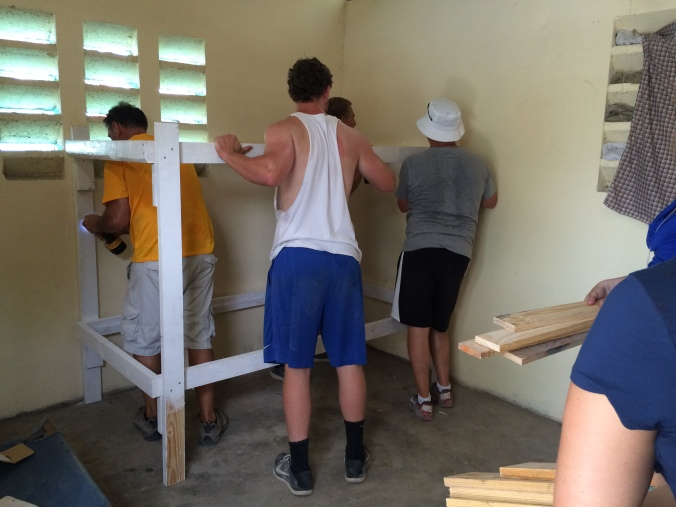 Delivering bunk beds to homes in the village.